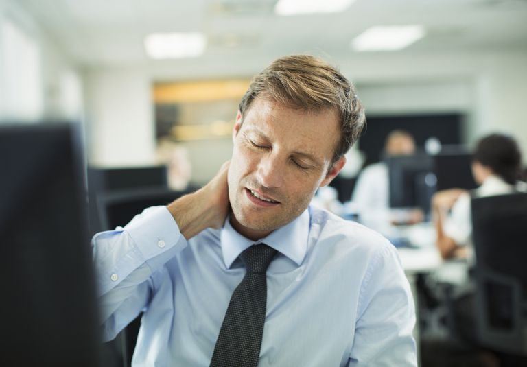 man with pain at office