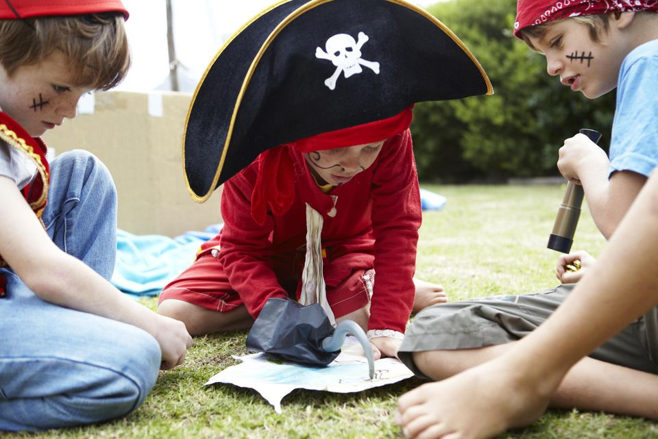 Boys playing pirates together