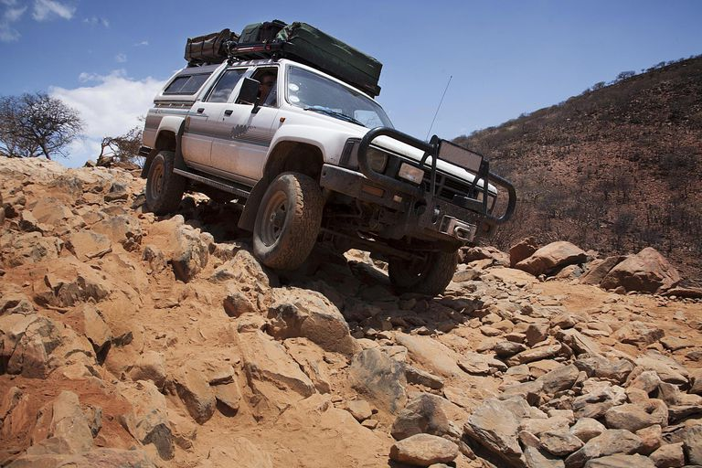 Jeep Driving Over Rocks in Namibia, Africa
