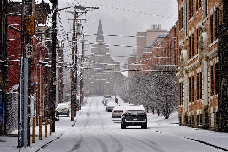 Snowy street with church