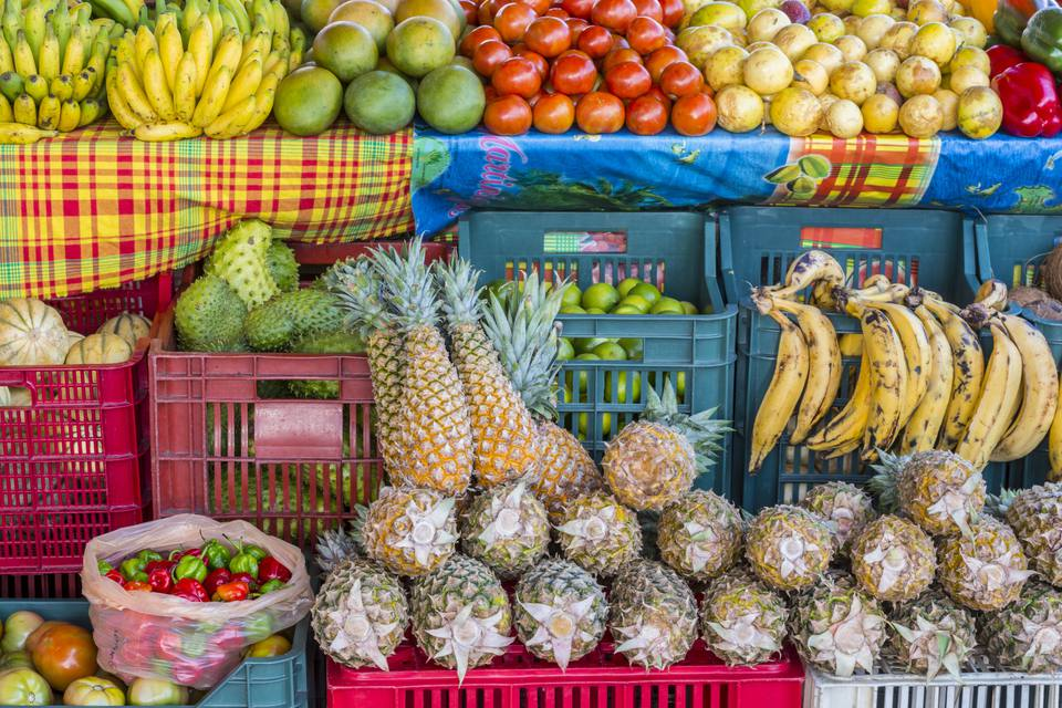 France, Guadeloupe (French West Indies), Grande Terre, Saint Francois, market stall with various local fruits and vegetables