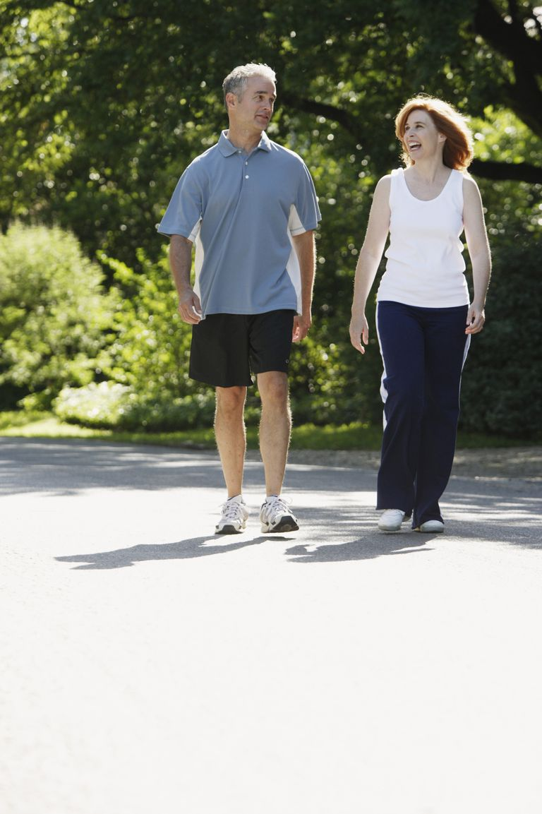 mature couple walking for exercise