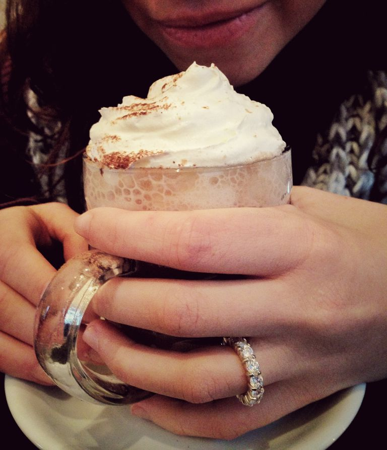 Midsection Of Woman Holding Hot Chocolate In Glass