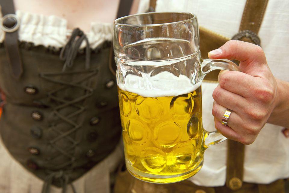 couple holding German beer stein