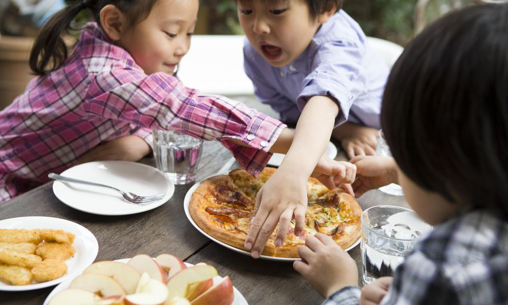 Children having lunch in the outside