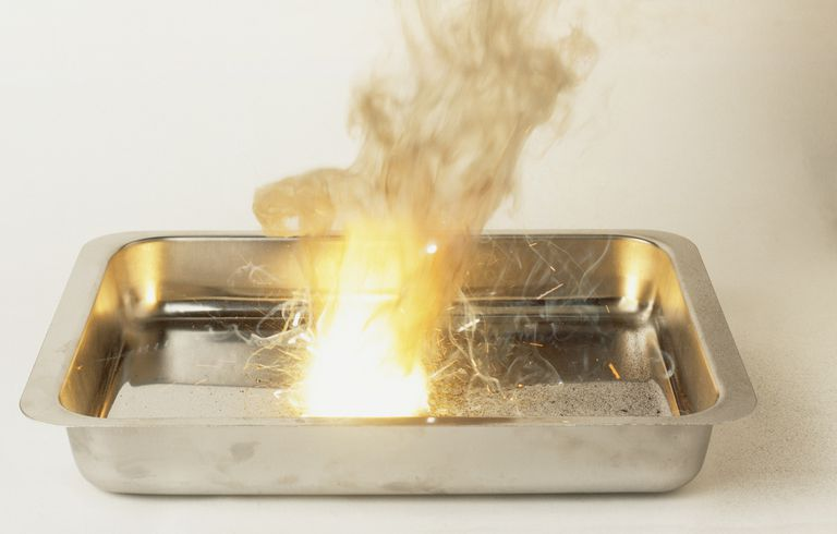 Metal tray with explosive thermite reaction occuring.