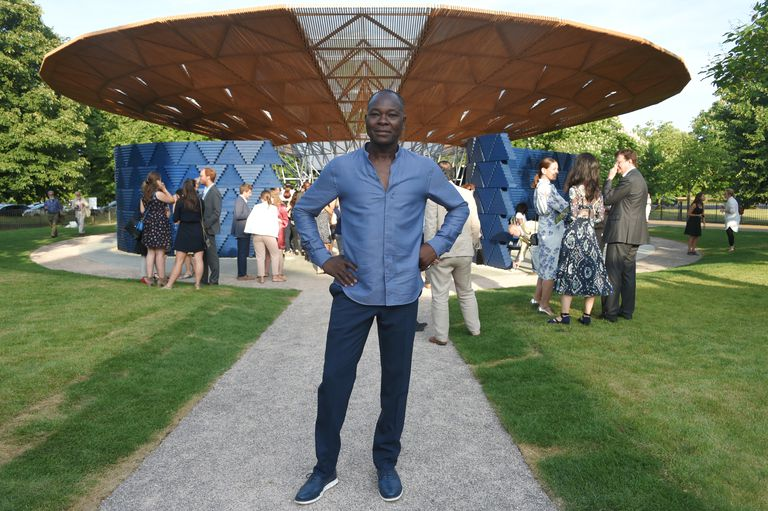 Francis Kere poses in front of the spaceship-like design of his 2017 Serpentine Gallery Pavilion in London