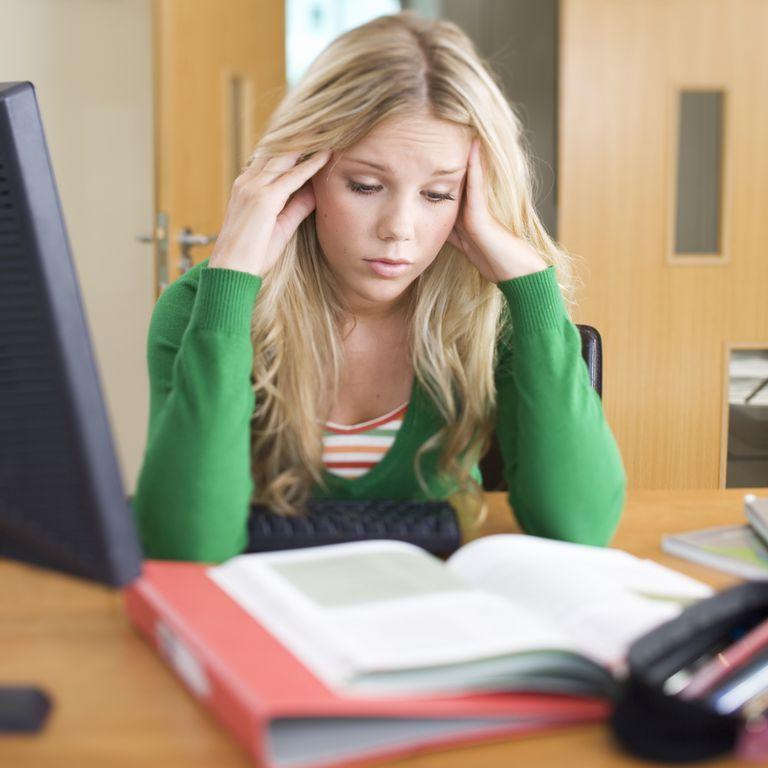 A teenage girl studying