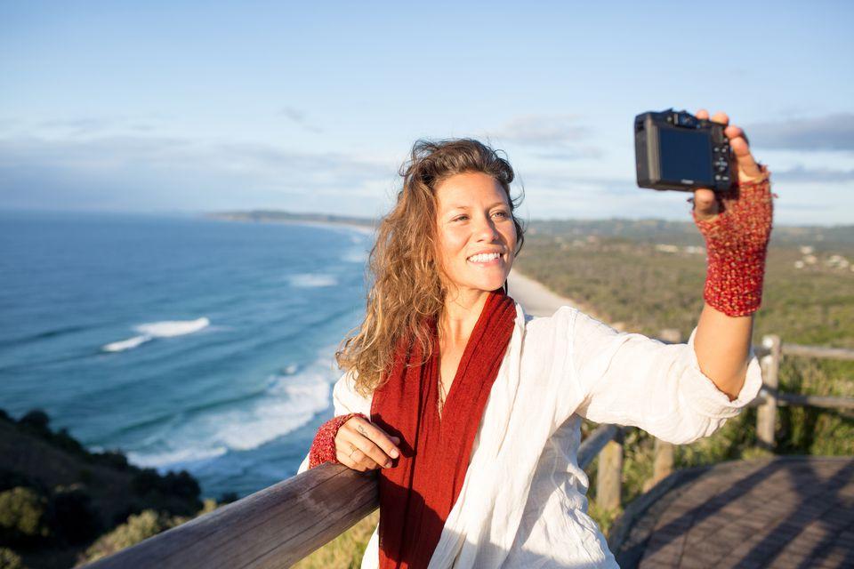 woman taking selfie at beach