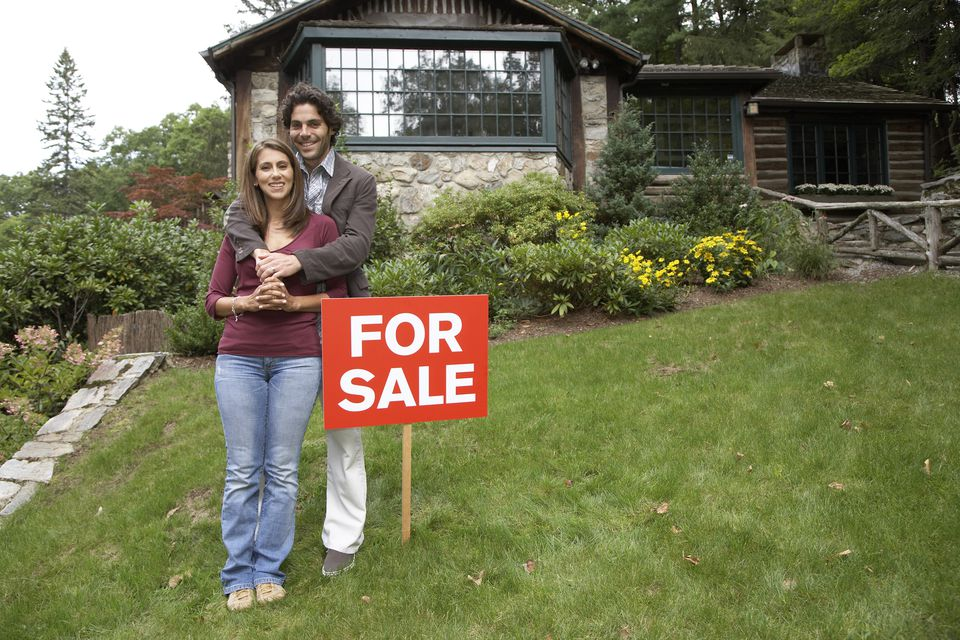 Young adult couple buying home
