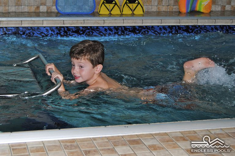boy using endless pool