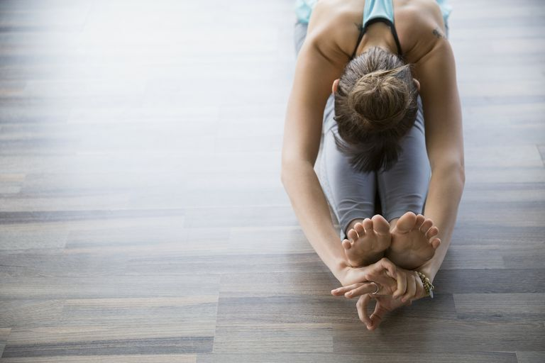 Woman stretching in a yoga pose