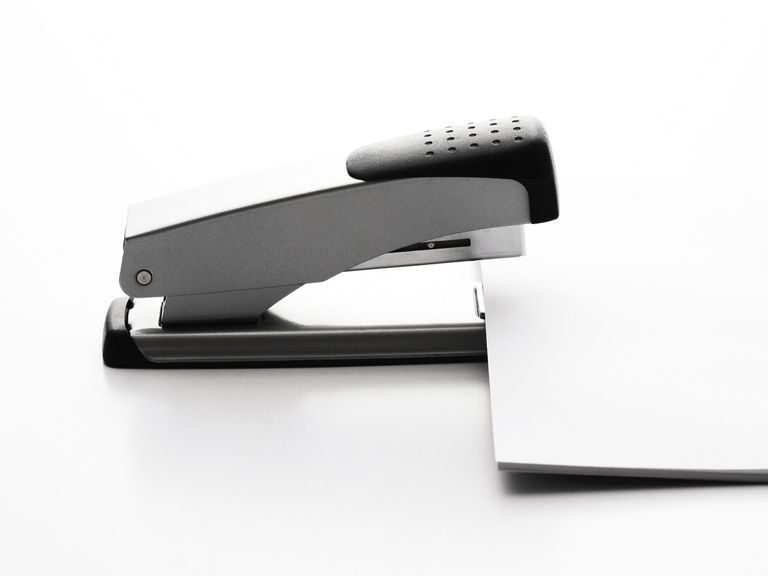 Fastening papers with a stapler