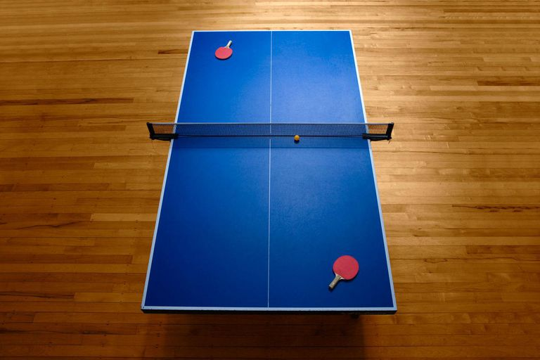 Table tennis table and paddles, elevated view