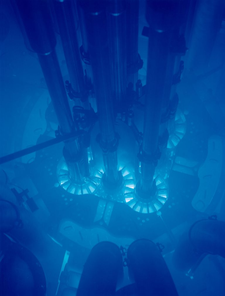 Cherenkov radiation causes water in a nuclear reactor to glow blue.