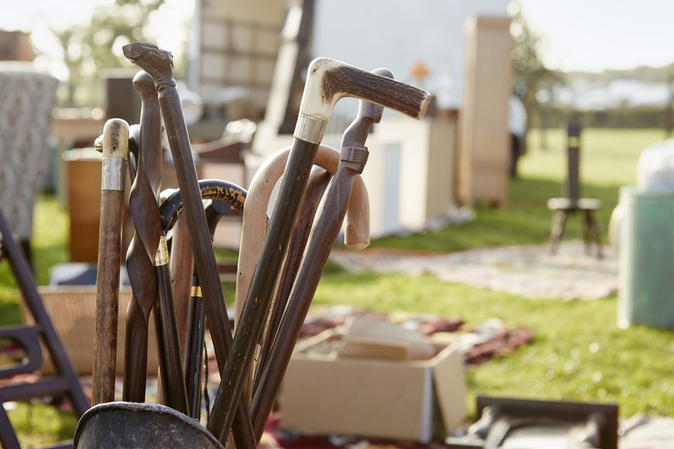 walking sticks for sale at highway yard sale