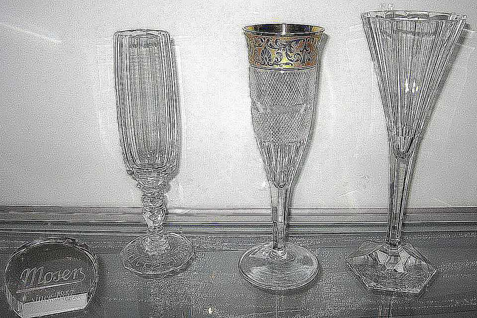 Various stemware glasses from Moser. Left: Maria Theresia 10620 champagne glass from 1913.