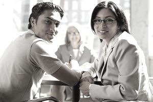 couple-signing-loan.jpg