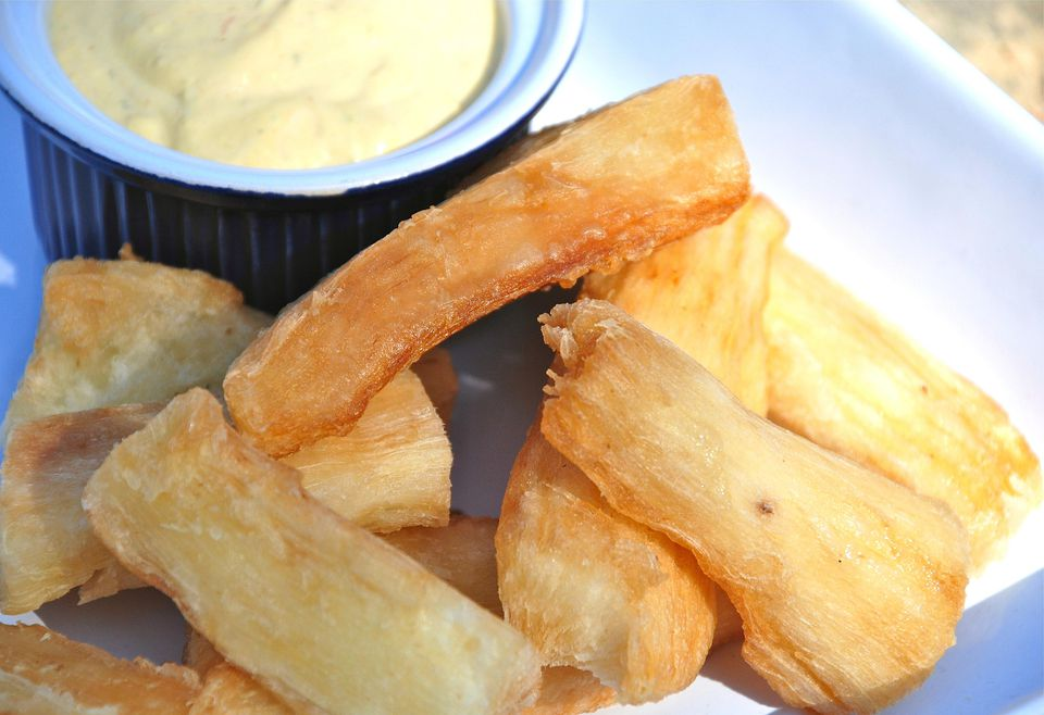 Crispy Yuca Fries on a plate with dipping sauce