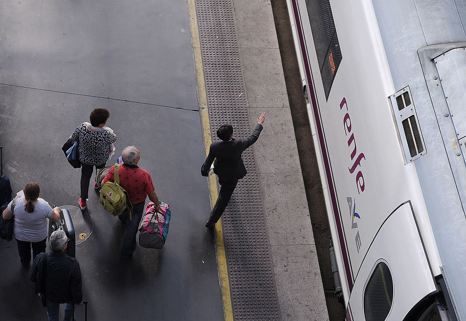 Passengers board AVE high-speed trains at Atocha train station on October 8, 2015 in Madrid, Spain.