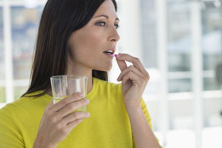woman taking medicine