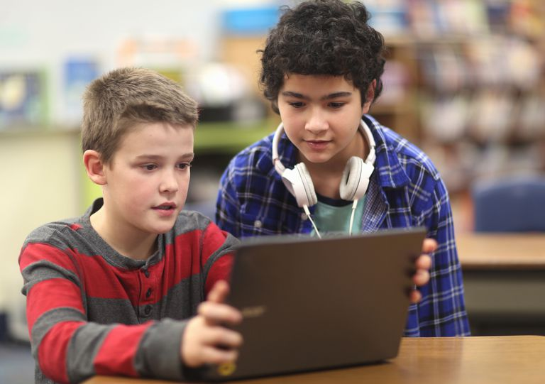 fourth grade friends - boys with laptop