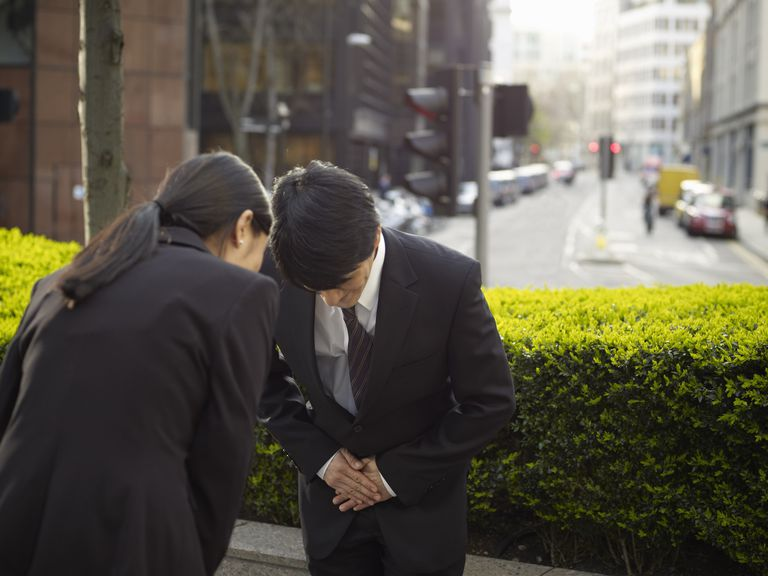 Business people bowing to each other