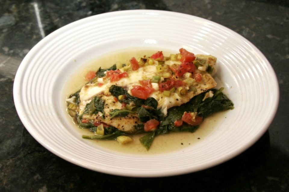Baked tilapia with spinach and tomatoes