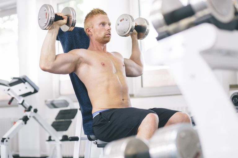 Athlete exercising with dumbbells