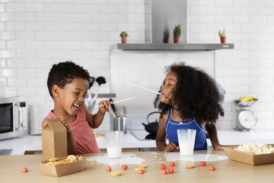 Kids playing with milk