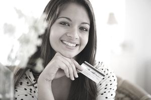 Woman smiling holding credit card