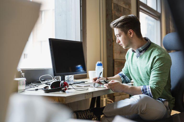 Man writing in workstation