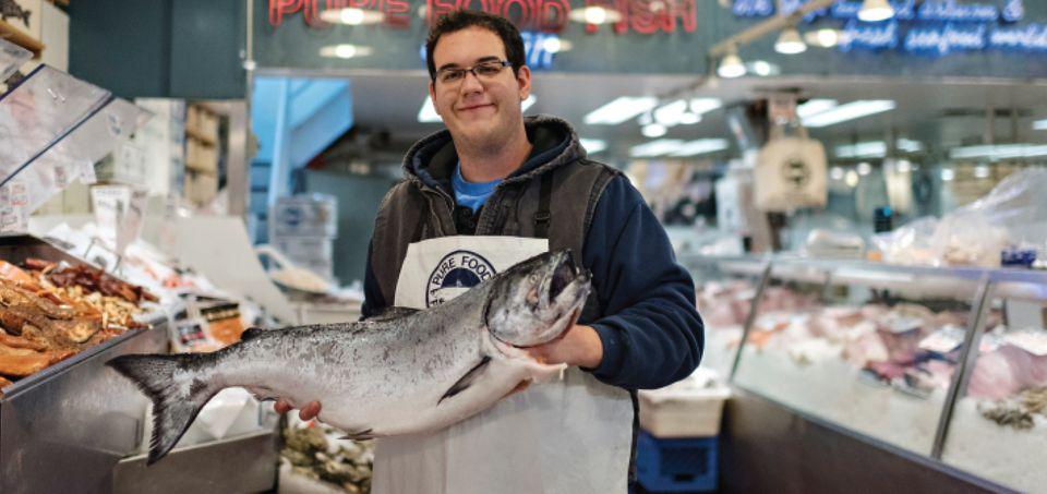 Purveyor holding large fish