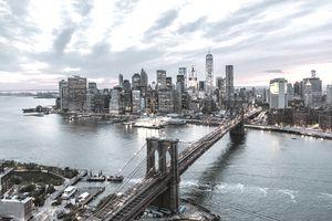 Aerial of New York city and Brooklyn bridge at dusk
