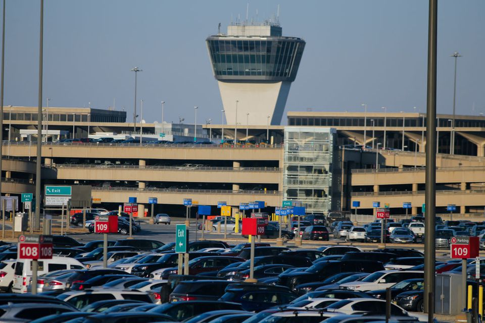 ars are seen on the Newark airport parking lot