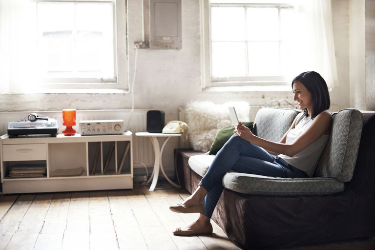 woman using tablet in living room
