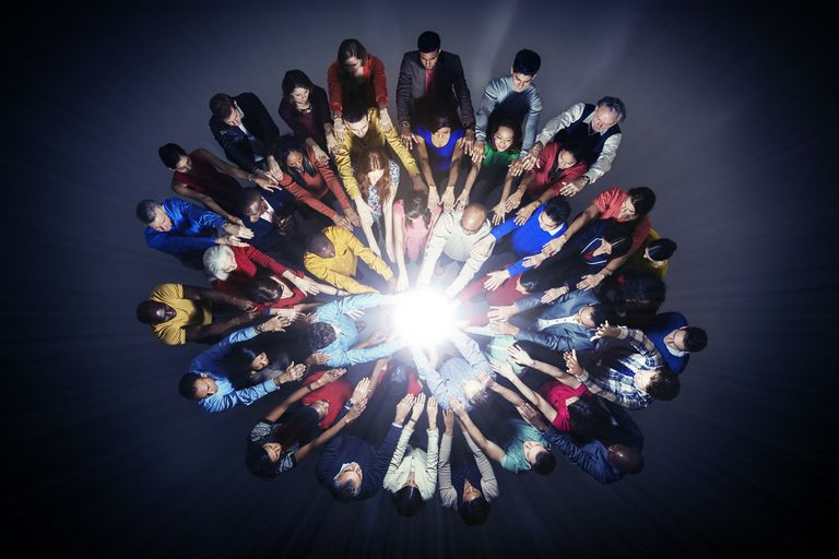 group of people with orb light