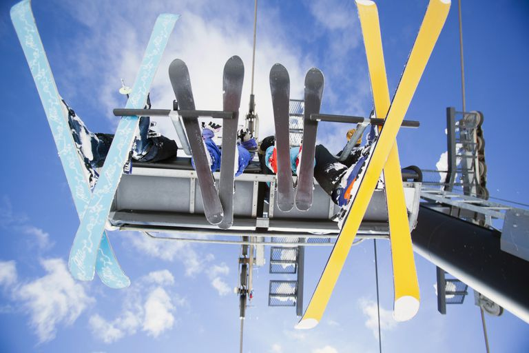 USA, Montana, Whitefish, Family of skiers on ski lift seen from below