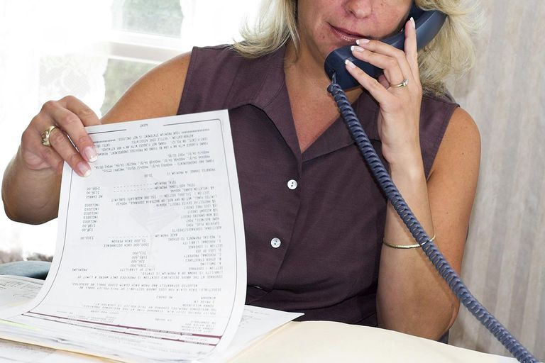 Professional agent on phone discussing paperwork