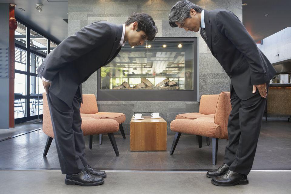men bowing in japan