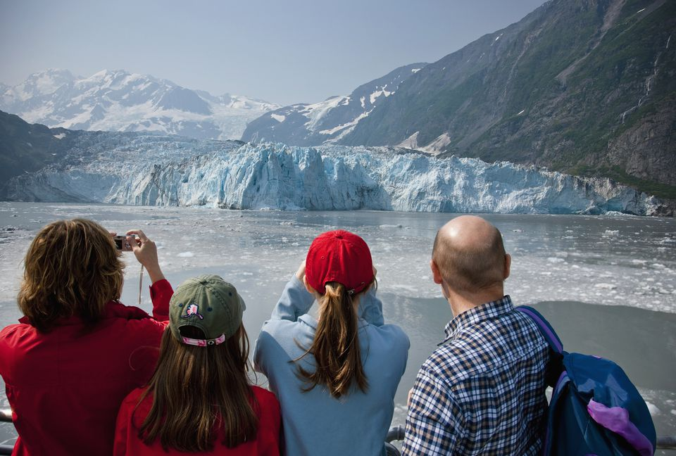 Family Sightseeeing While On A Day Cruise In Prince Wiliam Sound With Harriman Glacier In The Background, Southcentral Alaska, Usa.