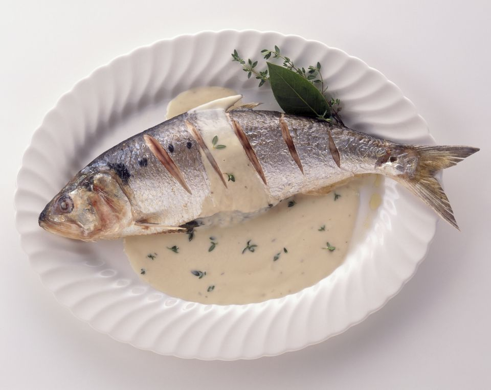 Alose a l'Oseille, grilled shad served with creamy sorrel sauce, a typical dish from the Loire Valley, France, view from above