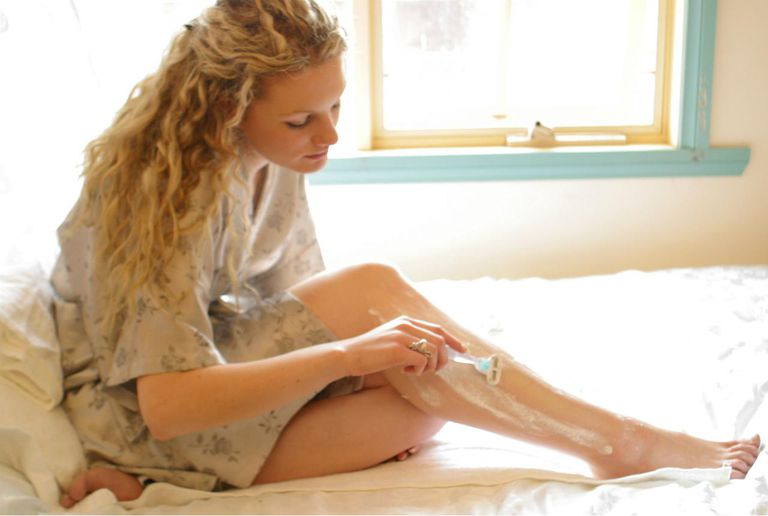 Pretty Blonde Woman Shaving Legs
