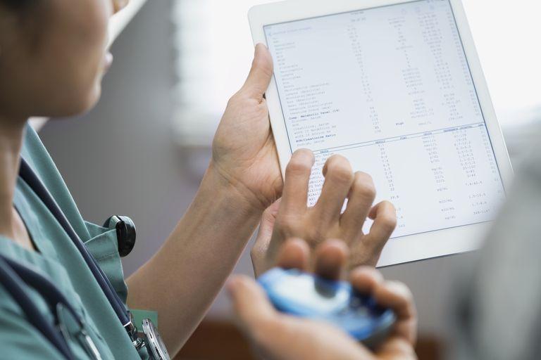 Nurse showing patient digital tablet