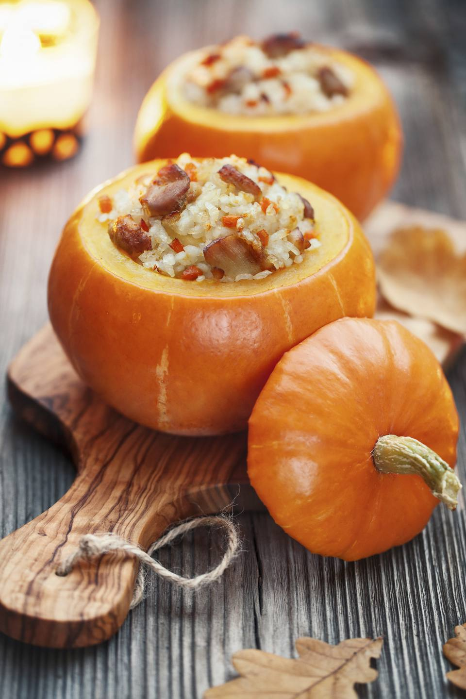 Roasted little pumpkins stuffed with chicken meat, vegetables an