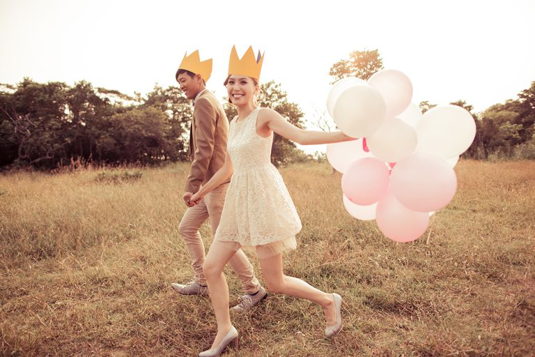 A Couple Wearing Crowns