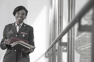 Army nurse holding papers and files