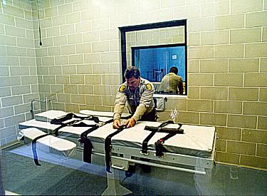A lethal injection gurney. The straps hold the prisoner down during the injection.