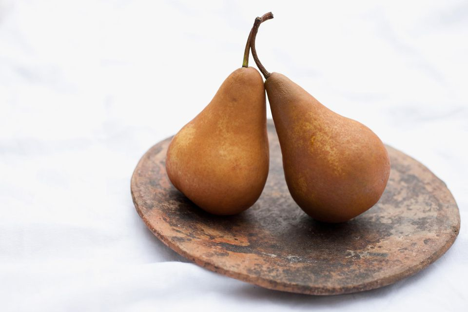 Close up of pears on wooden circle
