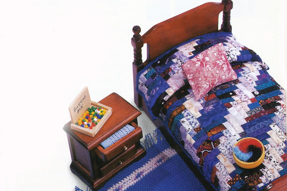 Log Cabin Dollhouse Quilt on Bed